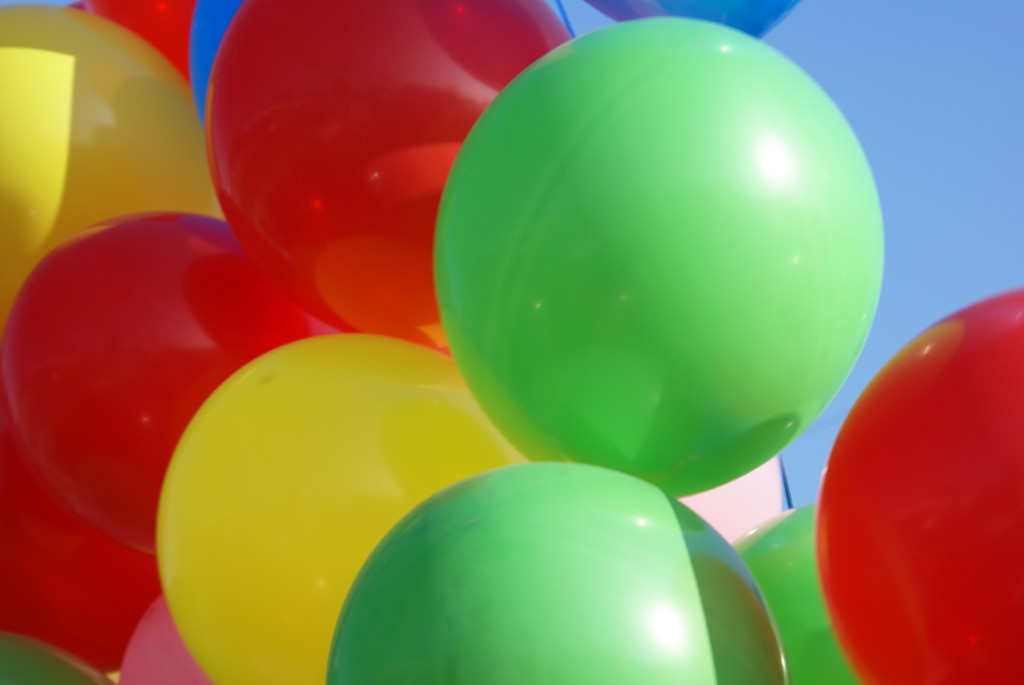 Helium balloons float because they are less dense than air